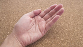 Upturned left hands for holding something on cork wood background Royalty Free Stock Image