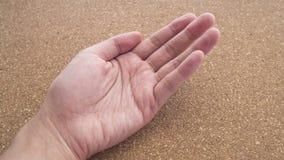 Upturned left hands for holding something on cork wood background Royalty Free Stock Image