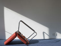 Upturned Office Chair Casting Shadow On Wall Stock Images