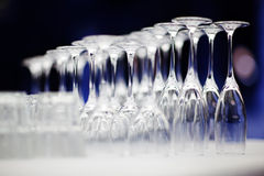 Upturned set of wine glasses on blurred blue. Background with extremely shallow depth of field Royalty Free Stock Photos