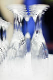 Upturned set of wine glasses on blurred blue. Background with extremely shallow depth of field Stock Image