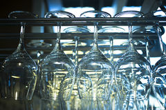 Upturned wine glasses in restaurant bar close-up Royalty Free Stock Photography