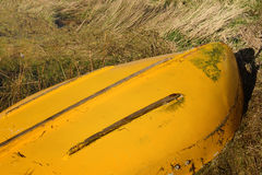 Upturned yellow row boat Stock Photo