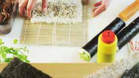 Upturning Mat With Rice. Sushi making. Close-up. Shot on RED Epic stock video