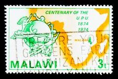 UPU emblemat i mapa Afryka, stulecie Ogólnoludzkiego Pocztowego zjednoczenia seria około 1974, Zdjęcie Stock