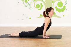 Upward Dog during yoga Stock Photo
