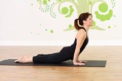 Upward Dog during yoga. Female practicing yoga, upward dog Stock Photo