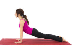 Upward Facing Dog Pose in Yoga. Young woman doing Upward Facing Dog in Yoga (Series with the same model available Royalty Free Stock Photo