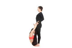 Upward Facing Forward Bend yoga pose with partner Royalty Free Stock Images