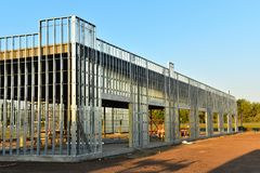 Upward growth of new steel frame commercial building. stock images