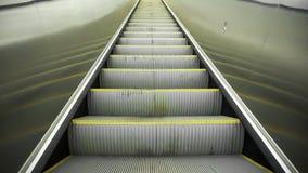 Upward movement standing on an empty escalator stock footage