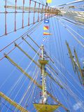 Upward Ship Masts. Description: A view of the masts of a tall ship from below. Many ropes and some flags are visible stock photo