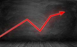 Upward trending bright red zigzag arrow on checkered black wall Royalty Free Stock Photos