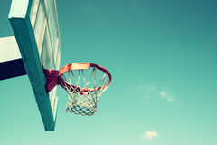 Upward view of basketball hoop against sky Royalty Free Stock Photos
