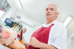 Upward view butcher holding knife Royalty Free Stock Image