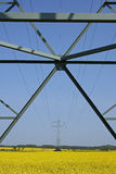 Upward view of cables on pylon. An upward shot of an electricity pylon, with cables hung on it stock images