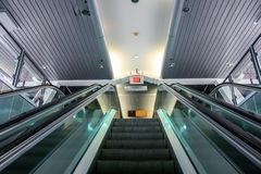 Upward view from an escalator with glass handrails.  royalty free stock photos