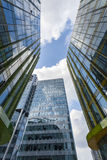 Upward view of modern glass buildings stock images