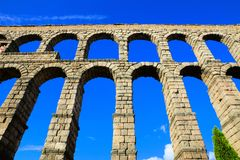 Upward view of the Roman Aqueduct of Segovia, Spain Stock Images