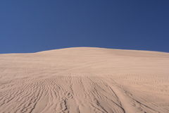 Upward view of sand dune in desert Stock Images