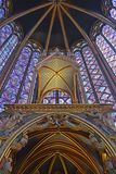 Upward view Beautiful stained glass windows in the upper level interior Sainte-Chapelle Paris France. Upward view of Stained Glass windows at the upper level Royalty Free Stock Photos