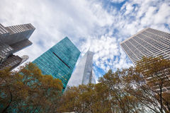 Upward view of tall New York City skyscrapers on a patchy cloudy Stock Photography