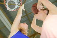Upward view woman aiming for basketball net Stock Photo
