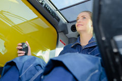 Upward view woman operating plant machinery Stock Images