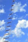 Upwards!. Rope ladder on the sky background Royalty Free Stock Photo