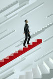 Upwards. Businessman climbs a red flying stairs. Royalty Free Stock Image