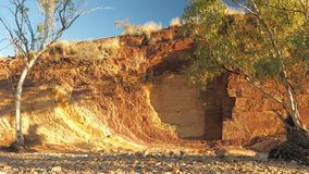 Upwards Ochre lines in the banks of a creek. At sunset in the McDonnell Ranges, place of indigenous Ochre mining, Alice Springs, Australia, July 2015 Royalty Free Stock Photos