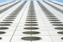 Upwards perspective of the distinctive circular windows of Jardine House, Hong Kong Stock Photo