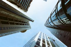 An upwards perspective of modern skyscrapers Stock Images