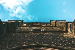 A shot of a church wall looking at the sky royalty free stock photo