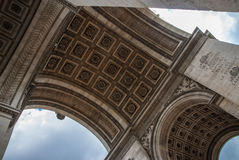 Upwards view beyond Arc de Triomphe in Paris Royalty Free Stock Images