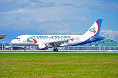 Ural Airlines Airbus A319 aircraft is landing in Pulkovo International airport in Saint-Petersburg, Russia Royalty Free Stock Photo