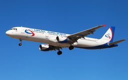 Ural Airlines Airbus A321. An Ural Airlines Airbus A321-211 approaching to El Prat Airport in Barcelona, Spain Stock Image
