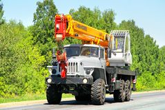 Ural 4320. CHELYABINSK REGION, RUSSIA - MAY 21, 2013: Grey Ural 4320 mobile crane at the interurban road Stock Photography