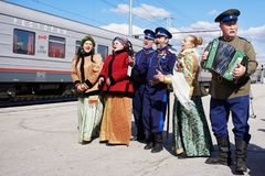 Ural Cossacks meet the train at the city station. Folk customs and folklore. Russian hospitality royalty free stock photography