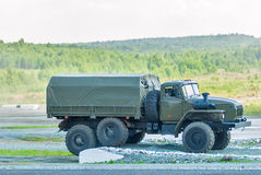URAL-4320 curtain sided truck comes around on high obstacle Stock Photos