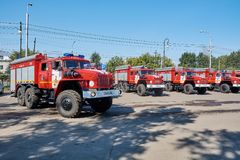 URAL 5557 fire brigade. Krasnoyarsk, Russia - August 25, 2018: The solemn delivery of new fire trucks to crews of MES dated for a celebrating the birthday of the royalty free stock photo