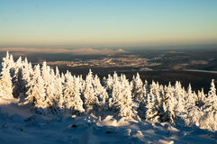 Ural Mountains in winter. Snowy pine trees and a small town in the Ural mountains in winter Stock Photography