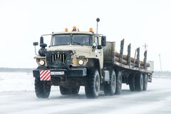 Ural 44202. Novyy Urengoy, Russia - May 8, 2016: Semi-trailer truck Ural 44202 at the interurban road during a heavy northern blizzard stock images
