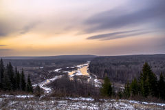 Ural river at sunset. River, forest, sunset, village, view from a high cliff on the river Sylva Stock Photography