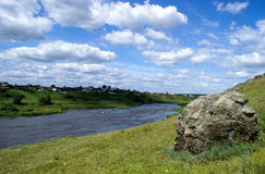 The Ural river. Under the blue sky with white clouds Stock Images