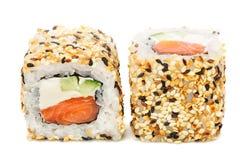 Uramaki maki sushi, two rolls isolated on white Stock Image