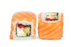 Uramaki maki sushi, two rolls isolated on white Royalty Free Stock Image