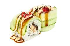Uramaki maki sushi, two rolls  on white Royalty Free Stock Image