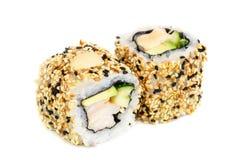 Uramaki maki sushi, two rolls  on white Stock Photo