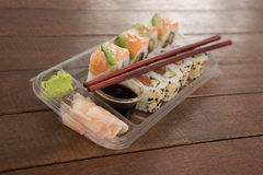 Uramaki and nigiri sushi served with chopsticks and soy sauce in plastic box Royalty Free Stock Photos
